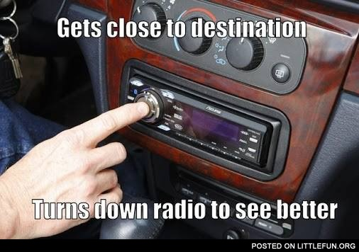 Turns down radio to see better