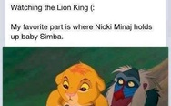 Nicki Minaj holds up baby Simba