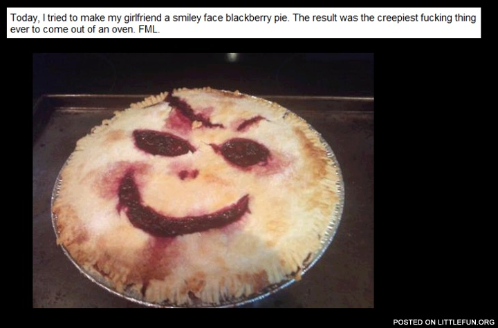 A smiley face blackberry pie