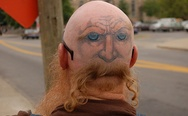 Bald head tattoo. The face with a mustache.