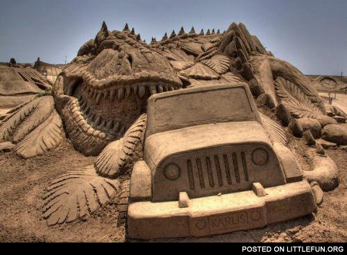 Cool dinosaur and Jeep sand sculpture