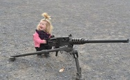Little funny girl with a gun