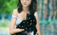 A girl with the many-eyed cat